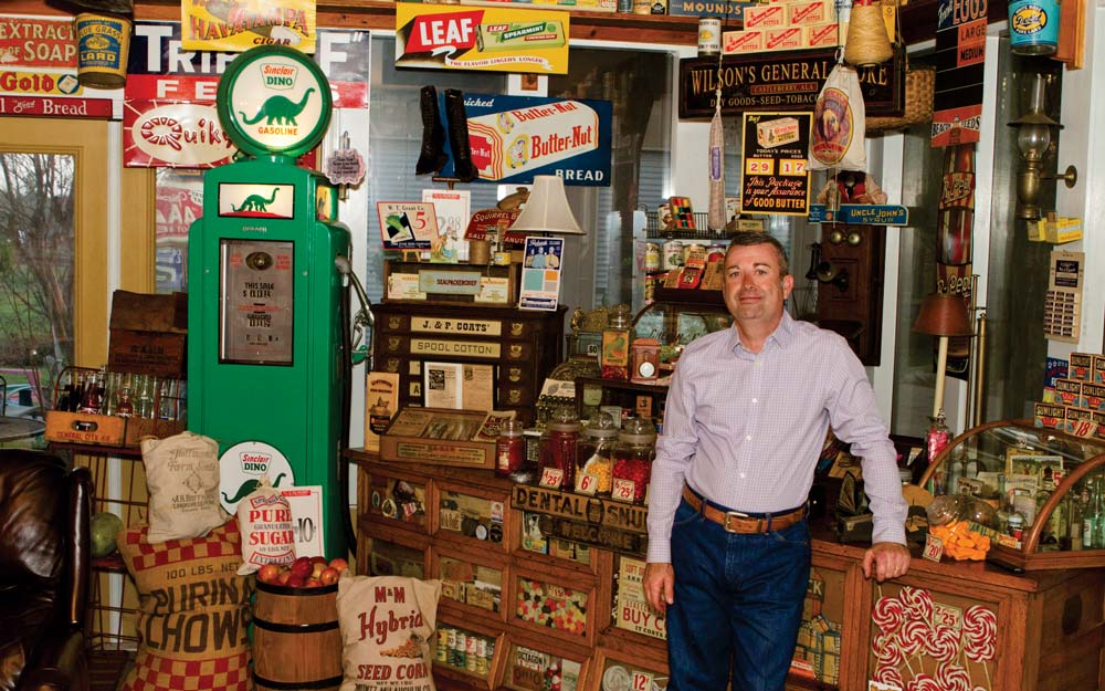 """The Wilson Sun Room houses close to 175 signs from yesteryear. """"I've collected general store memorabilia since I was a kid. My most prized piece  is a vintage Sherer Seed Counter that came from a country store in our town . . .  the owner said he was going to chunk it unless I took it . . .  I took it."""""""